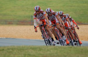 team of cyclists riding in a line