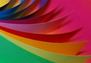 brightly colored paper fanned out