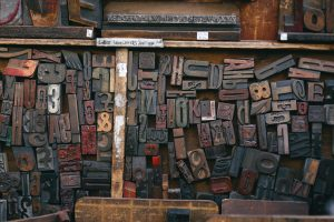 various sizes and fonts of letter rubber stamps in a jumble.