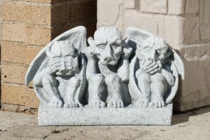 Gargoyles with eyes covered, mouth covered and ears covered.