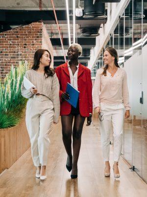 3 businesswomen walking in an office